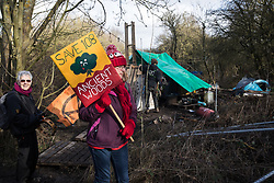Uxbridge, UK. 1 February, 2020. Environmental activists from Stop HS2, Save the Colne Valley and Extinction Rebellion campaigning against the controversial HS2 high-speed rail link pass through the woodland camp part of Harvil Road wildlife protection camp during a 'Still Standing for the Trees' march from Harefield through Denham Country Park to three addresses closely linked to Boris Johnson in his Uxbridge constituency. The Prime Minister is expected to make a decision imminently as to whether to proceed with the high-speed rail line.