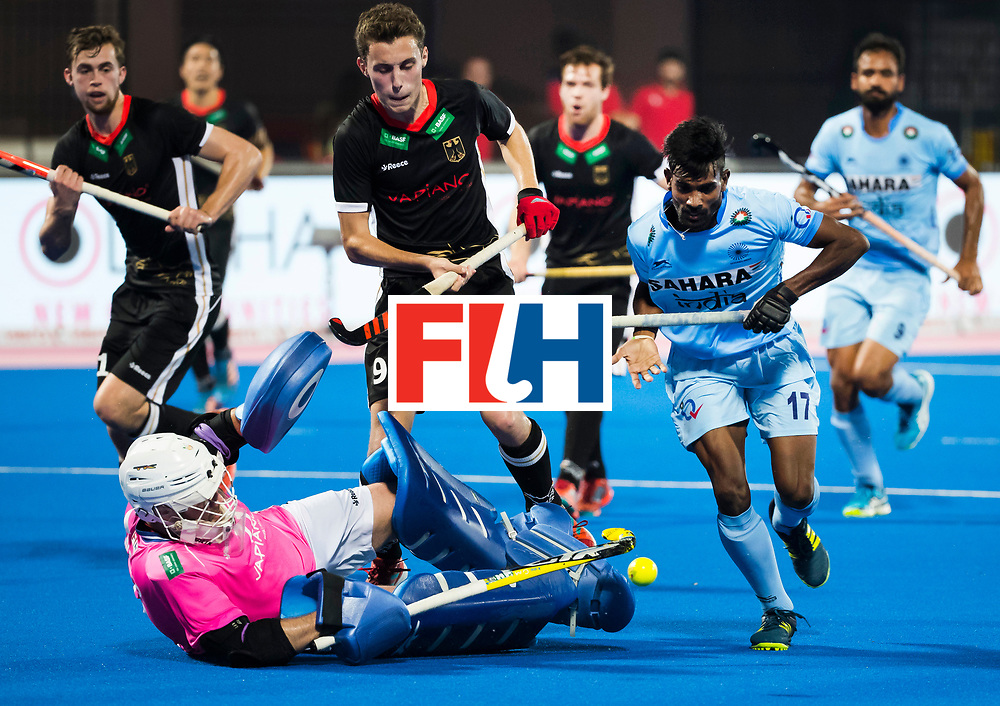 BHUBANESWAR - Hockey World League finals Match for bronze , Germany v India (1-2). Sumit (Ind)  with keeper Tobias Walter (Ger) . middle Johannes Grosse (Ger) COPYRIGHT KOEN SUYK