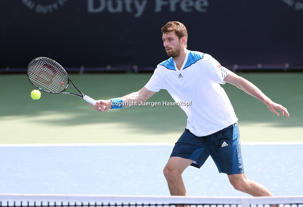 Dubai Tennis Championships 2014, ATP Tennis Turnier,International Series,Dubai Tennis Stadium, U.A.E.,<br /> Daniel Brands (GER),Aktion,Einzelbild,Halbkoerper,Querformat,