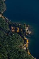 Aerial view of shoreline along Comox Lake.  Courtenay, The Comox Valley, Vancouver Island, British Columbia, Canada.
