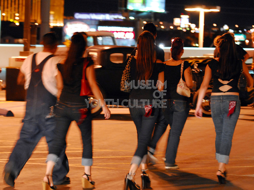 A group of friends, dressed in 50's style walking at night.Viva Las Vegas Festival, Las Vegas, USA 2006.