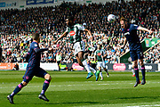 Matt Clarke (5) of Portsmouth leaps to head the ball away from Moses Makasi (14) of Plymouth Argyle during the EFL Sky Bet League 1 match between Plymouth Argyle and Portsmouth at Home Park, Plymouth, England on 14 April 2018. Picture by Graham Hunt.