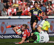 Lions v Highlanders. Ruan Combrinck of the Emirates Lions is tackled by Ben Smith (Captain) of the Highlanders during the 2016 Super Rugby semi-final match at Ellis Park, Johannesburg, 30 July 2016. <br /> <br /> © Anton de Villiers / www.photosport.nz