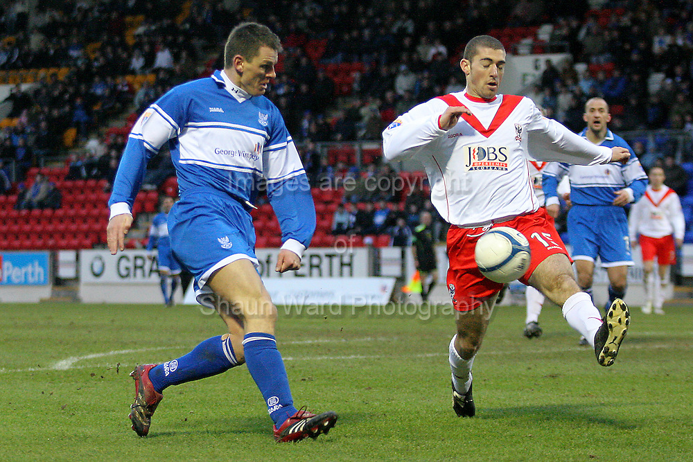 St Johnstone's Martin Hardie and Airdie Utd's Xavier Barrau in action in the Scottish First Division match played at Mc Diarmid Park 20th January 2007.