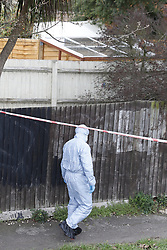 © Licensed to London News Pictures. 07/03/2019. London, UK. A forensics officer passes a property in Kew, West London, where a tent covers the body of a woman discovered by police in a shallow grave in the garden. Laureline Garcia-Bertaux, 34, from Richmond, was reported missing after she did not turn up for work on Monday, 4 March. . Photo credit: Peter Macdiarmid/LNP