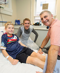 REPRO FREE: 12/11/2014 Irish Profetional Cyclist and world number 9 Dan Martin finished off an eventfull year by visiting the children of Temple Street Hospital. Dan is pictured with 12 year old kidney transplant patient Reuben Walsh and his father and kidney donor Michael from Clonakilty Co. Cork. Dan presented a cheque to the hospital as part of the Cycle4Life initiative witch has raised €500K to date. Picture Andres Poveda