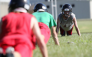 Clayton Visek (right), 18, senior, helps lead a drill during the first day of football practice at Central City High School in Central City on Wednesday afternoon, August 3, 2011.