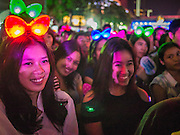 31 DECEMBER 2012 - BANGKOK, THAILAND:  Thai teenagers at the New Year's Eve Party in Ratchaprasong Intersection in Bangkok. The traditional Thai New Year is based on the lunar calender and is celebrated in April, but the Gregorian New Year is celebrated throughout the Kingdom, especially in larger cities and tourist centers, like Bangkok, Chiang Mai and Phuket. The Bangkok Countdown 2013 event was called ?Happiness is all Around @ Ratchaprasong.? All of the streets leading to Ratchaprasong Intersection were closed and the malls in the area stayed open throughout the evening.   PHOTO BY JACK KURTZ