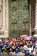 School children at the entrance to Cathedral of Santa Maria del Fiore (Duomo), Florence, Tuscany, Italy