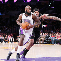 28 February 2014: Sacramento Kings small forward Quincy Acy (5) drives past Los Angeles Lakers power forward Jordan Hill (27) during the Los Angeles Lakers 126-122 victory over the Sacramento Kings at the Staples Center, Los Angeles, California, USA.
