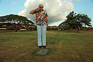 Al Diaz/Herald Staff--Dec. 7th 1994 -- Pearl Harbor survivor, Gerald Glaubitz salutes an unknown soldier at National Memorial Cemetery of the Pacific, Hawaii.