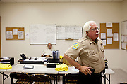 A meeting room for The Posse, which is a volunteer sheriff's department in Sun City, Arizona August 2010. Dave Randall, right, moved to Sun City in 2003. The Sun City residents who make up the Posse volunteer up to 2,000 hours a year and are required to undergo the same training as true deputies..2010 marks the 50th anniversary of the United States' first planned retirement city. When Del Webb created Sun City and it opened in 1960, it was a revolutionary idea for retirees to move away from home and to live extremely active and social lifestyles..