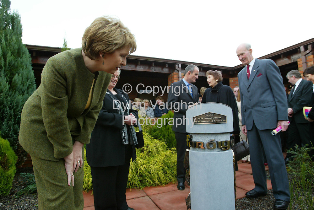 14/11/2002.The President of Ireland Mary McAleese pictured yesterday looking at a commemorative sculpture to celebrate 50 years of Foroige.The President unveiled the sculpture at Colaiste Cois Siuire in Mooncoin County Kilkenny..Picture Dylan Vaughan