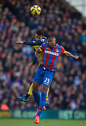 LONDON, ENGLAND - Saturday, February 21, 2015: Arsenal's Francis Coquelin in action against Crystal Palace's Shola Ameobi during the Premier League match at Selhurst Park. (Pic by David Rawcliffe/Propaganda)