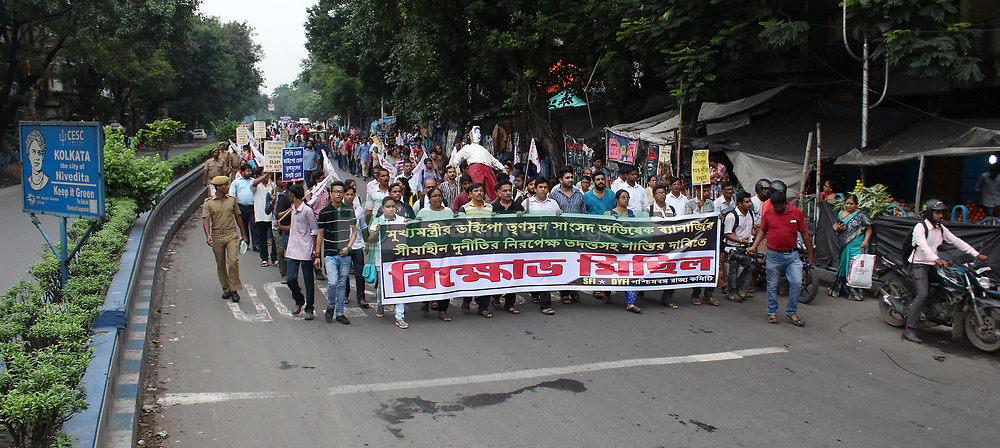August 4, 2017 - Kolkata, West Bengal, India - Student Federation of India(SFI) and DemocraticYouth Federation of India(DYFI) leaders  and supporters during a protest rally against Trinomool Congress(TMC) Member of Parliament  Abhishek Banerjee over charged financial seam and  protest demand for immediate arrest of Trinomool Congress(TMC) Member of Parliament  Abhishek Banerjee on Aguest 04, 2017 in Kolkata in India..Student Federation of India(SFI) and DemocraticYouth Federation of India(DYFI) leaders  and supporters during a protest rally against Trinomool Congress(TMC) Member of Parliament  Abhishek Banerjee over charged financial seam and  protest demand for immediate arrest of Trinomool Congress(TMC) Member of Parliament  Abhishek Banerjee on Aguest 04, 2017 in Kolkata in India. (Credit Image: © Sanjay Purkait/Pacific Press via ZUMA Wire)