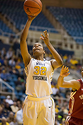West Virginia Mountaineers forward Crystal Leary (32) shoots a layup against the Oklahoma Sooners during the second half at the WVU Coliseum.