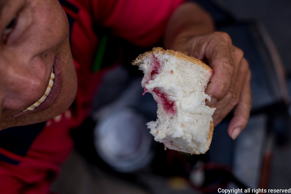 Motorcycle deliveryman's breakfast - white bread with grape jelly. George Town, Penang, Malaysia