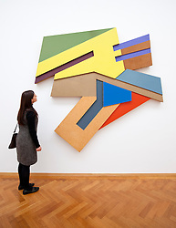 Woman looking at Uzlany by Frank Stella at the Gemeentemuseum in The Hague, Den Haag,  Netherlands
