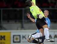 13-09-2008 VOETBAL:FC TWENTE:NEC NIJMEGEN:ENSCHEDE <br /> Sander Bosker kan de bal net wegstompen voor Bas Sibum er bij kan komen<br /> Foto: Geert van Erven