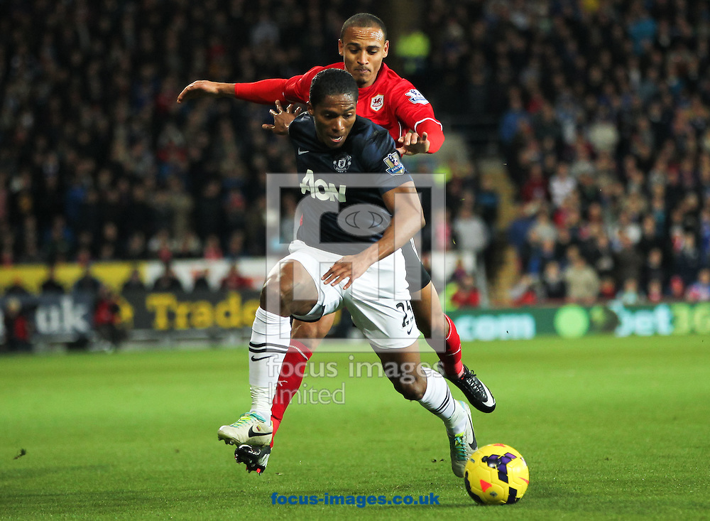 Picture by Tom Smith/Focus Images Ltd 07545141164<br /> 24/11/2013<br /> Peter Odemwingie (back) of Cardiff City tries to keep up with Luis Antonio Valencia (front) of Manchester United during the Barclays Premier League match at the Cardiff City Stadium, Cardiff.
