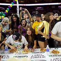 "Eventual champion Patrick ""Deep Dish"" Bertoletti (right) competes against defending champion Molly Schuyler (left), eating 444 chicken wings to win in the final round of Wingbowl, on January 30, 2015 at the Wells Fargo Center in Philadelphia, PA.  In its 23rd year, and considered the premier competitive eating contest, contestants eat as many spicy chicken wings as possible.  There's a parade of colorful costumes and wingette cheerleaders before the event.  The sold old event of 20,000+ spectators starts at 6am with the winner taking home a $10,000 prize. REUTERS/Mark Makela (UNITED STATES)"