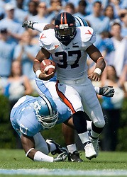 Virginia running back Cedric Peerman (37) beats North Carolina linebacker Wesley Flagg (51).  The North Carolina Tar Heels football team faced the Virginia Cavaliers at Kenan Memorial Stadium in Chapel Hill, NC on September 15, 2007.  UVA defeated UNC 22-20.