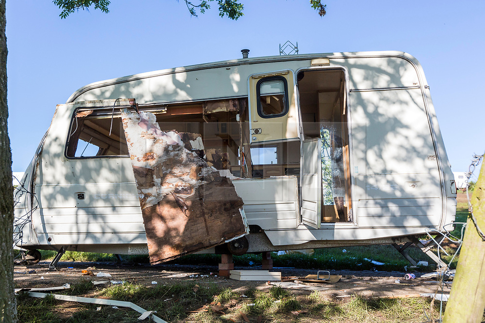© Licensed to London News Pictures. 10/06/2019. Appleby UK. A smashed up Caravan is among the rubbish that has been left behind this morning by Travellers leaving the Appleby Horse Fair in Cumbria. Appleby Horse Fair attracts around 10,000 Gypsies & Travellers & is thought to be the largest Gypsy Fair in Europe. Photo credit: Andrew McCaren/LNP