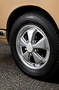 Image of a tan sports car wheel detail in Seattle, Washington, Pacific Northwest, Porsche 1967 911S, property released
