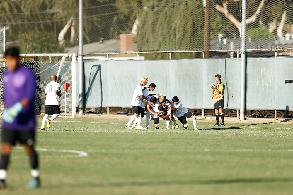 Golden West College celebrates after team member scores point. Golden West College defeats Fullerton 1-0.<br /> <br /> Photo by Ozzy Jaime, Sports Shooter Academy