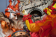 Carnival characters pose in costume in San Marco square in Venice during the carnival.