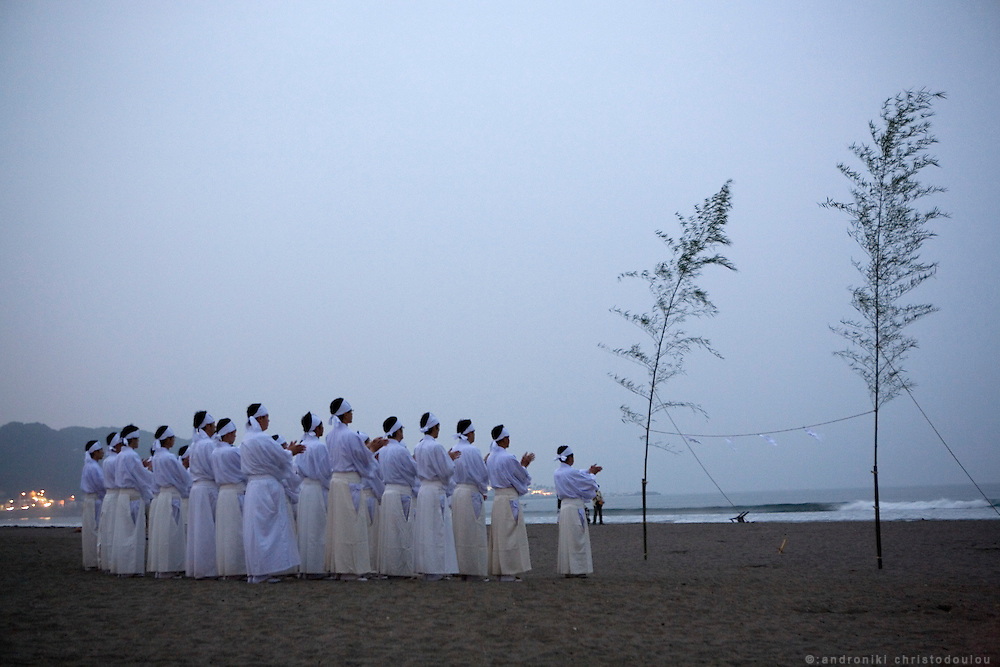 Morning purification of Shinto prieasts in the sea, at 5 am on the first day of the 3-day anual ritual of Tsurugaoka Hachimangu Shrine in Kamakura