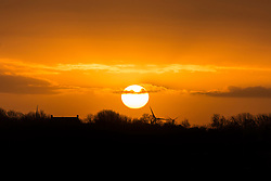 © Licensed to London News Pictures. 16/01/2016. Whittlesey UK. Photograph shows this morning's sunrise over the Fenland town of Whittlesey that later today host's the 37th Straw Bear festival. Photo credit: Andrew McCaren/LNP