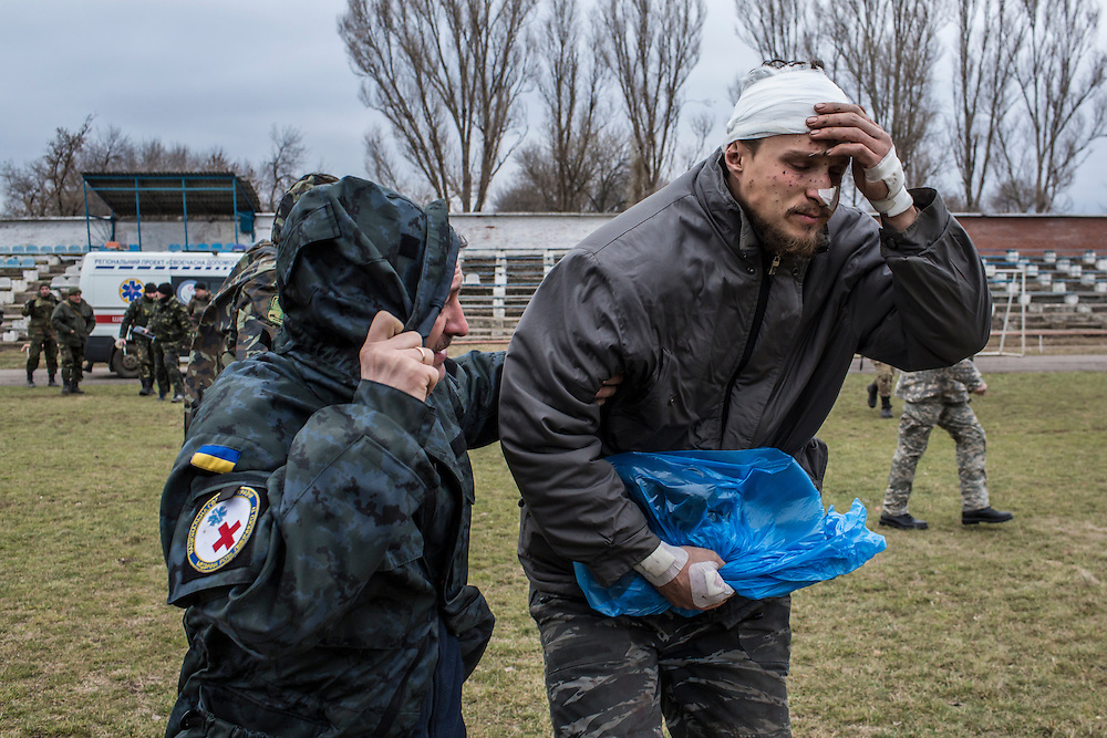 ARTEMIVSK, UKRAINE - FEBRUARY 8, 2015: A wounded Ukrainian soldier boards a medevac helicopter on a sports field, which will take him and others to Dnipropetrovsk for treatment in Artemivsk, Ukraine. Fighting between pro-Russia rebels and Ukrainian forces has dealt steady casualties to Ukrainian fighters and civilians. CREDIT: Brendan Hoffman for The New York Times