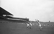 Kerry's G McMahon tries an overhead kick as Roscommon's G.O'Reilly and J.Lynch block him during the All Ireland Senior Gaelic Football Championship Final Kerry v Roscommon in Croke Park on the 23rd September 1962. Kerry 1-12 Roscommon 1-6.
