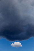 One white cloud with big black cloud, Serengeti National Park, Tanzania, Africa