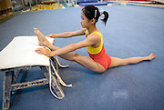A young girl warms up before an afternoon training session of the Beijing gymnastic team in Beijing.
