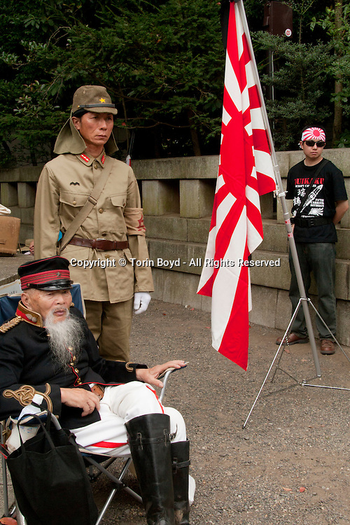 August 15, 2016, Tokyo, Japan: Today on the 71st anniversary of the end of World War II, tens of thousand came to pay their respects for Japan's war dead at Tokyo's Yasukuni Shrine, the national Shinto shrine where nearly 2.5 million war dead from the past 150 years are enshrined. Visits to Yasukuni by top Japanese politicians continue to outrage China and South Korea because it honors 14 World War II class A war criminals who are also enshrined there. Even so, dozens of Japanese lawmakers and 2 cabinet ministers visited Yasukuni Shrine today, while PM Shinzo Abe sent a ritual cash offering via his emissary. (Torin Boyd/Polaris).
