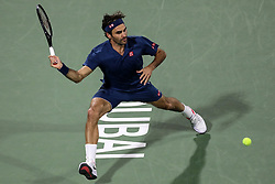 DUBAI, March 1, 2019  Roger Federer of Switzerland returns a shot during the singles quarterfinal match between Roger Federer of Switzerland and Marton Fucsovics of Hungary at the ATP Dubai Duty Free Tennis Championships 2019 in Dubai, the United Arab Emirates, Feb. 28, 2019. Roger Federer won 2-0 to proceed to the semifinals. (Credit Image: © Mahmoud Khaled/Xinhua via ZUMA Wire)