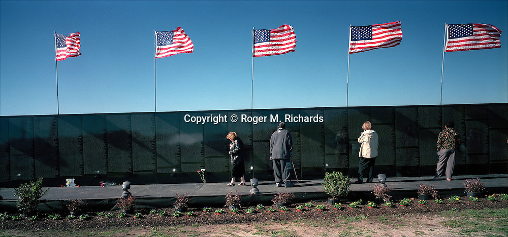 Traveling Vietnam Wall, a replica of the Washington DC Vietnam memorial that goes across the country.  Photograph by Roger M. Richards