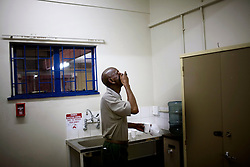 A miner with TB takes his daily medication at an Anglo Gold health facility.  Anglo Gold has one of the hope health systems in the industry for treating TB but it's TB rates remain constant with the industry average. South African Gold miners are particularly vulnerable to contracting TB because of the small, poorly ventilated work and living conditions, high rates of HIV and high rates of silicosis, a lung disease often found in miners that increases the chance of having active TB.
