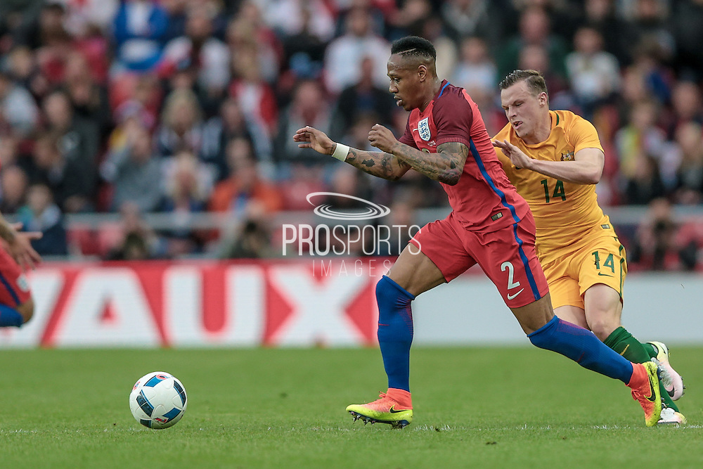Nathaniel Clyne (England) runs with the ball as Bradley Wright (Australia) chases after him during the Friendly International match match between England and Australia at the Stadium Of Light, Sunderland, England on 27 May 2016. Photo by Mark P Doherty.
