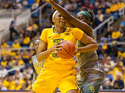 Jan 30, 2016; Morgantown, WV, USA; West Virginia Mountaineers center Lanay Montgomery (15) backs down Baylor Bears center Beatrice Mompremier (32) during the first quarter  at WVU Coliseum. Mandatory Credit: Ben Queen-USA TODAY Sports