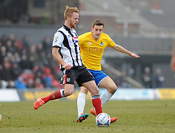 Grimsby's Craig Disley is challenged by Bristol Rovers' Tom Lockyer - Photo mandatory by-line: Neil Brookman/JMP - Mobile: 07966 386802 - 14/02/2015 - SPORT - Football - Cleethorpes - Blundell Park - Grimsby Town v Bristol Rovers - Vanarama Football Conference
