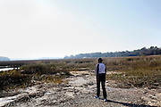 Monét Murphy, 19, a freshman Marine Science major, walks through a marsh on a hunt to find, gather and identify plants for a microcosm she built with a team in her Intro to Marine Science class at Savannah State University, an historically black university in Savannah, Georgia February 9, 2009. KENDRICK BRINSON