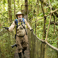 Photo Instructor Michael Nolan smiles as he walks on the rope bridge during a canopy walk at Amazon Natural Park in Peru.