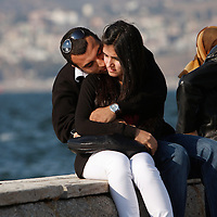 A couple embrace along the sea shore of Izmir, Turkey