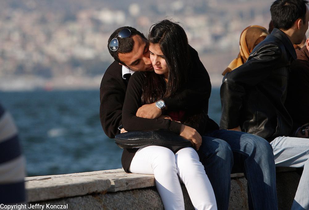 A couple embrace along the sea shore of Izmir, Turkey