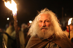 © Licensed to London News Pictures. 20/02/2016. York, UK. A man holds a flaming torch during the finale of the annual Jorvik Viking Festival in York, North Yorkshire. The historic city was transformed into a fiery battleground as this year's end to the week long festival told the story of the infamous Battle of Assundun. The festival, which is run by the Jorvik Viking Centre, takes place every February in tradition of an ancient Viking festival known as Jolablot.  Photo credit : Ian Hinchliffe/LNP