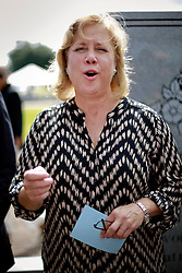 29 August 2014. Lower 9th Ward, New Orleans, Louisiana. Senator Mary Landrieu lays a wreath at the official memorial in remembrance of the day Hurricane Katrina swamped the community 9 years ago today..<br />