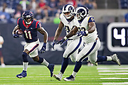 HOUSTON, TX - AUGUST 29:  Steven Mitchell Jr. #11 of the Houston Texans runs the ball and is chased by Marquise Copeland #93 and John Franklin-Myers #94 of the Los Angeles Rams during week four of the preseason at NRG Stadium on August 29, 2019 in Houston, Texas. The Rams defeated the Texans 22-10.   (Photo by Wesley Hitt/Getty Images) *** Local Caption *** Steven Mitchell Jr.; John Franklin-Myers; Marquise Copeland